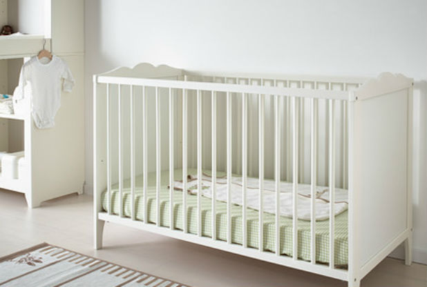 We have the Ikea Hensvik cot, which has a nice shaped top and adjustable height