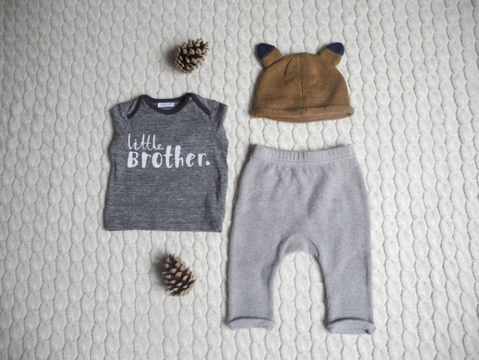 Knitted fox hat, £6; little brother tee, £5.50-£6.50; grey knit look trousers, £6-£7