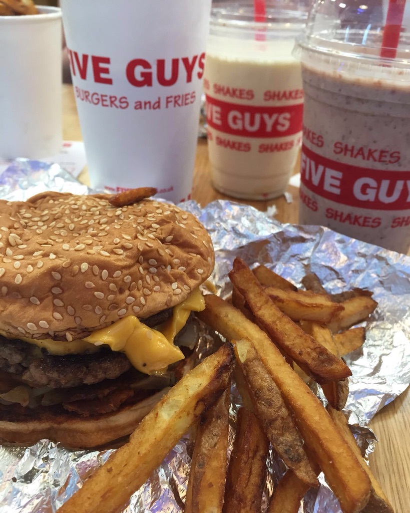 A Five Guys hamburger with fries